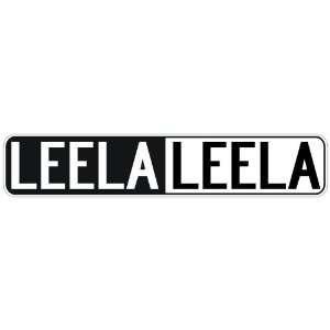 NEGATIVE LEELA  STREET SIGN