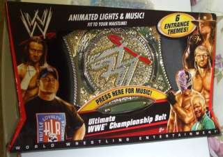 WWE ULTIMATE CHAMPIONSHIP BELT WITH 6 ENTRANCE THEMES MIP