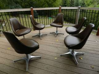 Mid century modern set of 6 vinyl chairs on heavy metal swivel bases