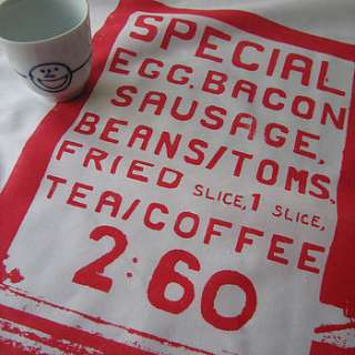 screenprinted tea towel with a Full English Breakfast menu print