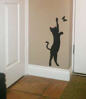cat and butterfly wall art sticker / decal by nutmeg